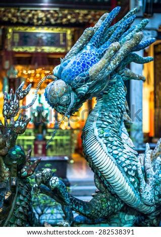 Blue dragon in a temple. Vietnam. - stock photo