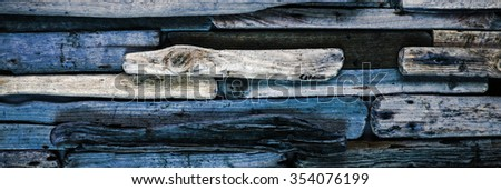 Blue driftwood -  imaginative background texture, with worn paint and rugged wood grain - abstract panorama / header / banner. - stock photo