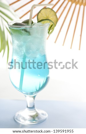 Blue drink cocktail with ice and lemon