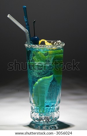Blue drink with citron and ice. Studio shot. - stock photo