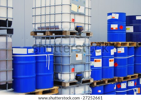 Blue drums on pallets in a warehouse - stock photo