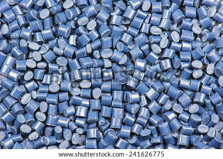 blue dyed synthetic polymer pellets for background - stock photo
