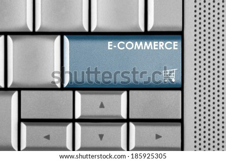 Blue E-Commerce key on a computer keyboard with clipping path around the E-Commerce key - stock photo