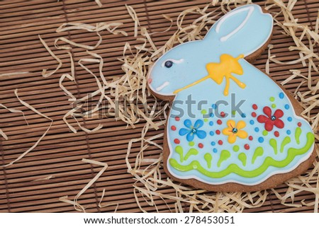 Blue Easter bunny gingerbread cookies on a wooden background