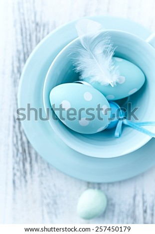 Blue easter eggs in a ceramic tea cup