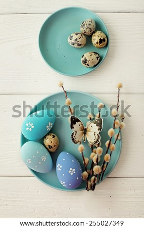 blue easter eggs on white wooden table - stock photo