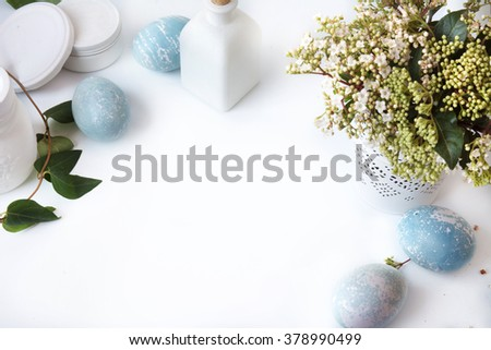 Blue Easter Eggs, overhead view, and bouquet of white flowers