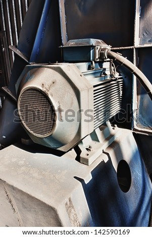 Blue electric motor at the plant.