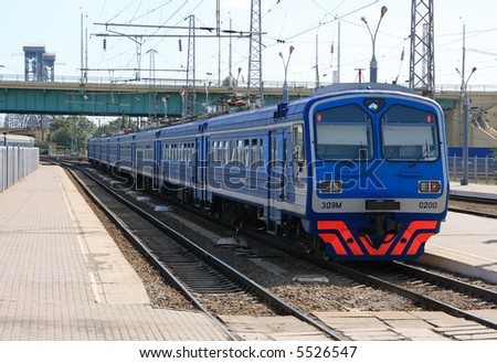 Blue electricity locomotive in station in morning hour