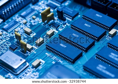 Blue electronic circuit close-up - stock photo