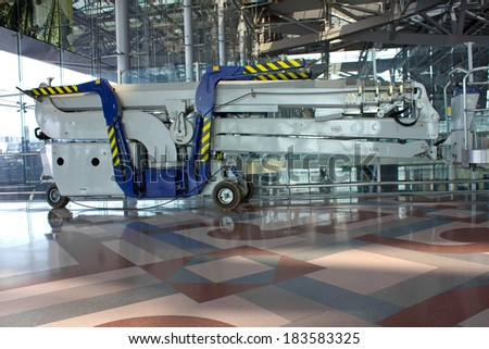 Blue elevator in airport building - stock photo