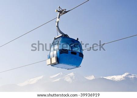 blue elevator ski cabin in Bansko ski center - Bulgaria - stock photo