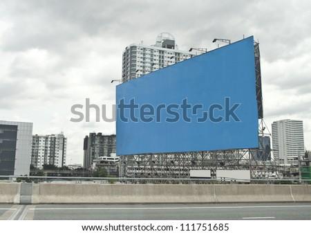 blue empty billboard on city. - stock photo