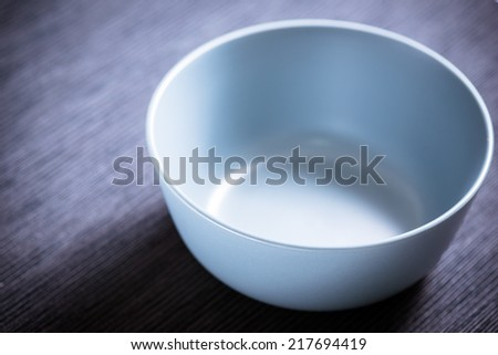 Blue empty bowl on black background