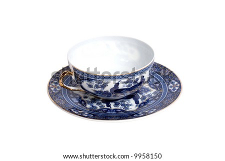 blue empty cup with a saucer on white background
