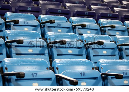 Blue empty seats on the stadium