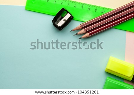 Blue empty sheet with stationery objects makes a great copy space for you message or drawing. - stock photo