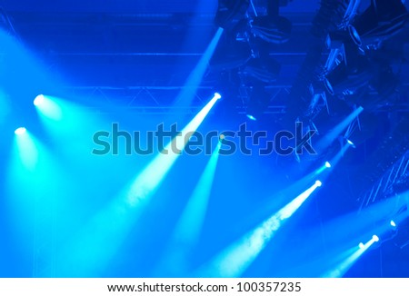 blue entertainment lights with fog, detail photo - stock photo