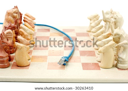 Blue ethernet cable running between chess set to depict on line gaming - stock photo