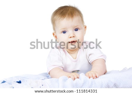 blue-eyed child lying on a white background