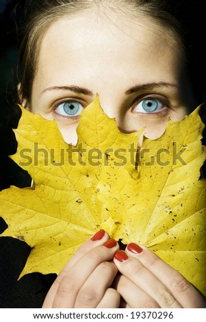 blue-eyed girl with bright leaf (original version) - stock photo
