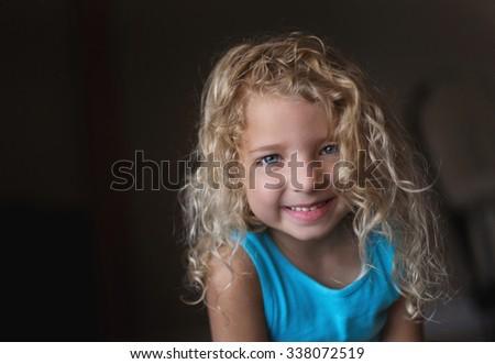 Blue eyed Toddler girl and big smile - stock photo