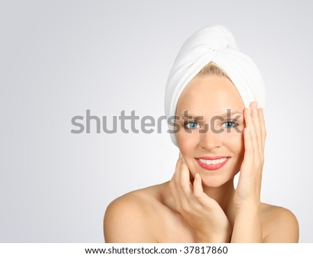 Blue Eyed Woman With a Towel on Hair Awaiting Spa Treatment - stock photo