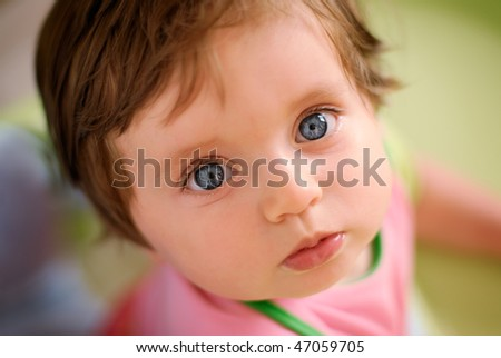 blue eyes baby looking at you - stock photo