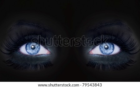 blue eyes darked face makeup black cat panther woman [Photo Illustration] - stock photo