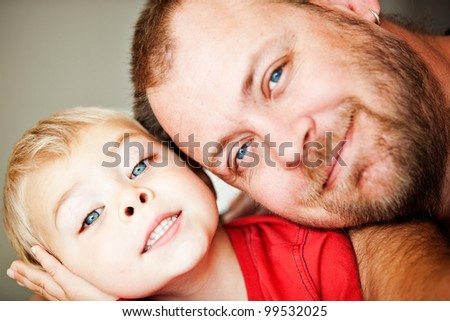 blue eyes happy father and toddler son closeup portrait - shallow depth of field, focus on child eyes - stock photo
