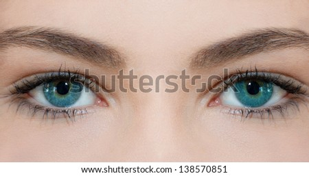 Blue eyes of young beautiful woman