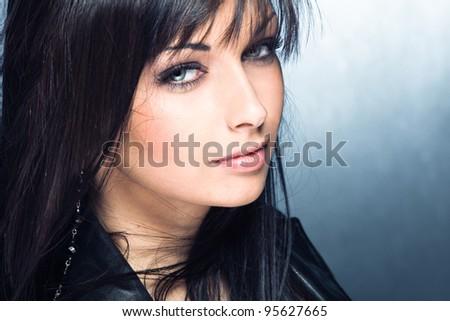 blue eyes young woman portrait, studio shot - stock photo