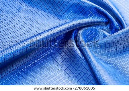 blue fabric texture in a section. tissue, textile, cloth,  material, cloth, typically produced by weaving or knitting textile fibers. - stock photo