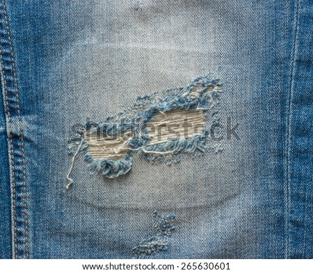 blue faded ripped jeans closeup - stock photo