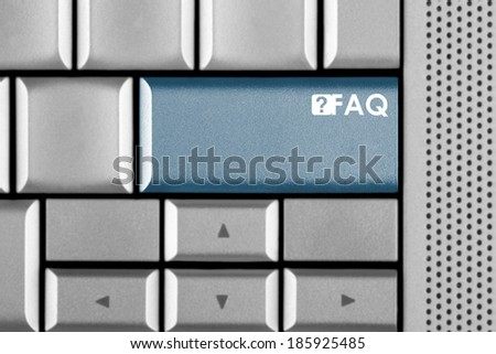 Blue FAQ key on a computer keyboard with clipping path around the FAQ key - stock photo
