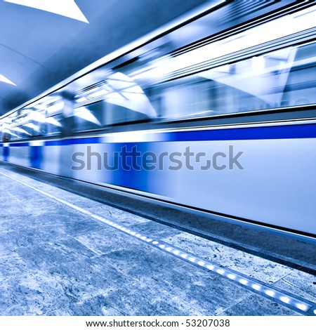 blue fast train on the underground metro station - stock photo