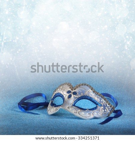blue female carnival mask and glitter background  - stock photo