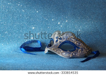 blue female carnival mask and glitter background. with glitter overlay  - stock photo