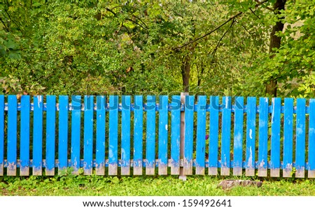 Blue fence in front of a property