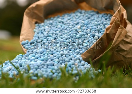Blue fertilizer in brown paper bag - stock photo