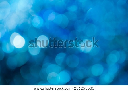 Blue festive Christmas background. Abstract with bright twinkles, sparkles, blurred, defocused light. - stock photo
