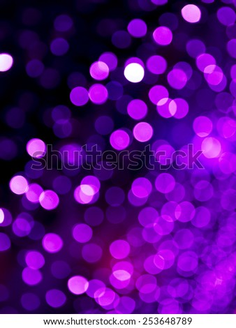 Blue Festive Christmas background with bokeh lights and stars