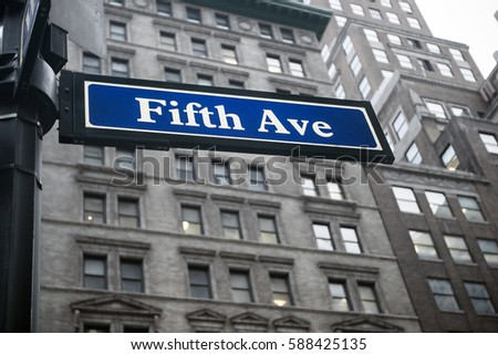 "Blue ""Fifth Ave"" street sign in Manhattan."