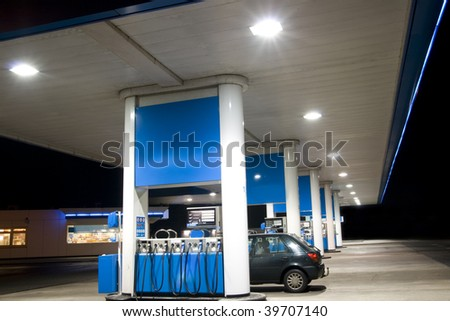 Blue filling station at night - stock photo