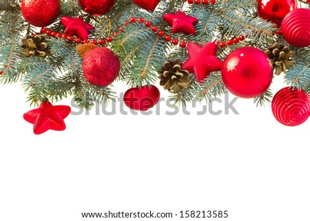 blue fir tree and red christmas decorations border on white background