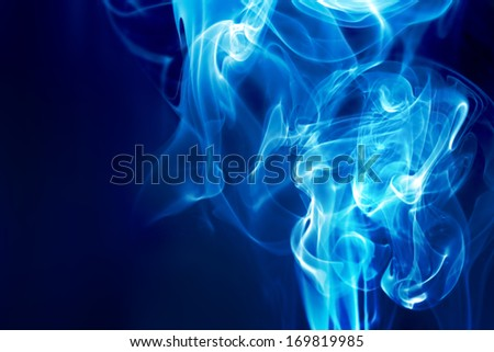 blue fire on a dark background - stock photo