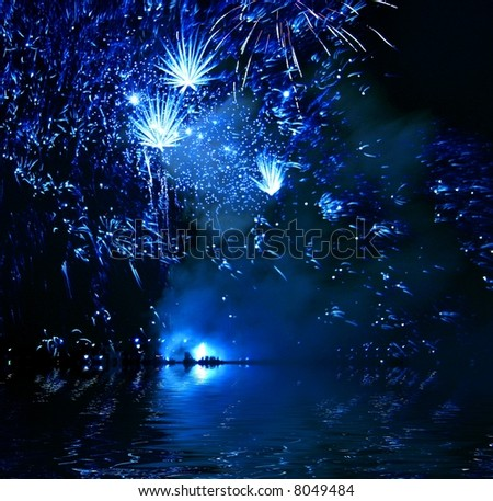 Blue Firework reflection in water - stock photo