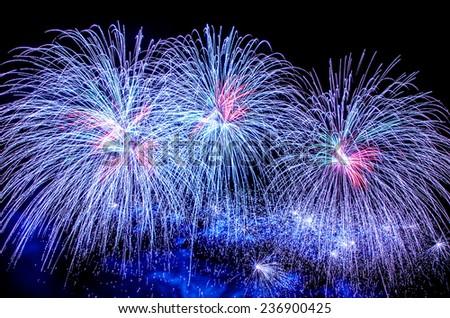 Blue fireworks display - stock photo