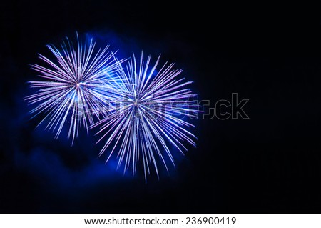 Blue fireworks with copy space - stock photo