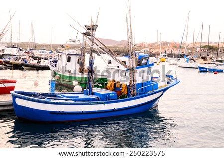 Blue Fishing Boat in the Early Morning - stock photo